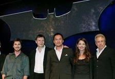 """<p>Actors Christian Bale of Britain, Liam Neeson of Ireland, Ken Watanabe of Japan, actress Katie Holmes of the U.S., and producer Charles Roven of the U.S. pose during a news conference to promote the new film 'Batman Begins' in Tokyo May 30, 2005. Elaborate DVD and Blu-ray Disc editions of """"Batman Begins,"""" """"Casablanca"""" and """"The Flintstones"""" top this year's slate of pricey gift sets from Warner Home Video, a category that experienced 26% growth in the past year, according to the studio. REUTERS/Toru Hanai</p>"""