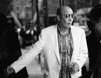 <p>Journalist Hunter S. Thompson enters a New York television studio on June 10 for an interview with talk-show host Charlie Rose. REUTERS/Stringer</p>