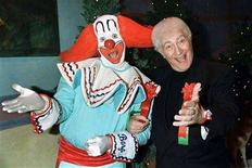 """<p>Larry Harmon (R), who popularized the """"Bozo the Clown"""" character and portrayed """"Bozo"""", is shown in this December 1, 1996 file photograph at a VIP party hosted by the Hollywood Christmas Parade with """"Bozo"""", one of the more than 200 clowns he has trained to play the role. Harmon, 83, died of congestive heart failure in Los Angeles on July 3, 2008 according to his publicist Jerry Digney. REUTERS/Fred Prouser</p>"""