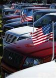 <p>New Ford trucks are on display for sale at a car lot in Carlsbad California January 14, 2008. REUTERS/Mike Blake</p>