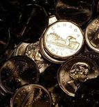 <p>Newly pressed Canadian one dollar coins, also know as loonies, at the Royal Canadian Mint in Winnipeg, November 14, 2007. REUTERS/Fred Greenslade</p>