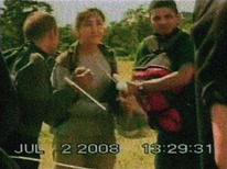 <p>Colombian politician Ingrid Betancourt (C) and other hostages wait to board a helicopter during a rescue operation in Colombia July 2, 2008 in this frame grab taken on July 4, 2008. Colombian movie director Simon Brand is teaming up with producers in Hollywood and his native country to bring to the big screen the story of last week's dramatic rescue of Betancourt and 14 other hostages in Colombia. REUTERS/Handout</p>