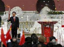 """<p>Chinese President Hu Jintao raises the Olympic torch during the """"Welcome Ceremony for the Olympic Flame and the Launching Ceremony of the Beijing 2008 Olympic Torch Relay"""" at Tiananmen Square in Beijing, March 31, 2008. REUTERS/Claro Cortes IV</p>"""