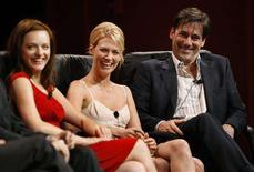 "<p>Cast member Jon Hamm (R) smiles next to co-stars January Jones (C) and Elisabeth Moss during a panel for the AMC television series ""Mad Men"" at the Television Critics Association 2008 summer press tour in Beverly Hills, California July 9, 2008. REUTERS/Mario Anzuoni</p>"
