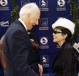 <p>Yoko Ono, widow of former Beatles member John Lennon, speaks with Beatles music producer Sir George Martin at the Grammy Foundation's Starry Night gala honoring Sir George Martin in Los Angeles, California July 12, 2008. REUTERS/Fred Prouser</p>