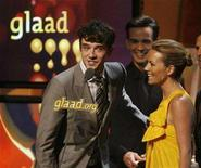 """<p>Michael Urie (L), Christopher Gorham (C) and Becki Newton, stars of the comedy television series """"Ugly Betty"""", accept the best comedy series award for the series at the 19th Annual Gay & Lesbian Alliance Against Defamation (GLAAD) Media Awards in Hollywood, April 26, 2008. REUTERS/Fred Prouser</p>"""