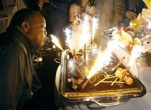 <p>U.S. music producer Quincy Jones blows the candles of his birthday cake during a party after the Quincy Jones 75th Anniversary celebration gig at the 42nd Montreux Jazz Festival early July 15, 2008. REUTERS/Denis Balibouse</p>