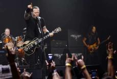 <p>Metallica libera álbum para videogame 'Guitar Hero'. Todas a músicas do novo disco do Metallica, 'Death Magnetic', ainda a ser lançado, estarão disponíveis para download para o videogame 'Guitar Hero III' e sua sequência, 'Guitar Hero World Tour'. Foto do Arquivo. Photo by Mario Anzuoni</p>