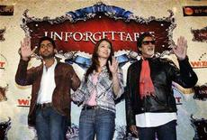 """<p>Bollywood actors (L-R) Abhishek Bachchan, Aishwarya Rai Bachchan and Amitabh Bachchan pose after speaking to the media to promote the """"Unforgettable"""" world tour in Toronto July 17, 2008. REUTERS/Mark Blinch</p>"""