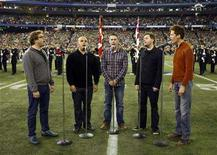 <p>Members of the band Barenaked Ladies sing the national anthem before the start of the 95th Grey Cup football championship in Toronto November 25, 2007. REUTERS/Shaun Best</p>