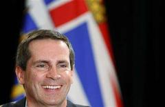 <p>Ontario's Premier Dalton McGuinty smiles during a news conference after the Council of the Federation at the Chateau Frontenac in Quebec City, July 18, 2008. REUTERS/Mathieu Belanger</p>