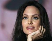 """<p>Angelina Jolie attends a news conference for the film """"The Exchange"""" by U.S. director Clint Eastwood at the 61st Cannes Film Festival May 20, 2008. Jolie has left the French hospital where she gave birth to twins last week, the hospital said on Saturday. REUTERS/Jean-Paul Pelissier</p>"""