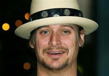<p>Singer Kid Rock arrives at the White House for a reception for the Kennedy Center Honors in Washington December 4, 2005. REUTERS/Joshua Roberts</p>