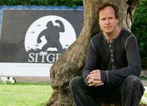 <p>U.S. Film director Joss Whedon poses during a photo call at the 38rd edition of the Sitge's Film International Festival of Catalonia, October 9, 2005. REUTERS/Gustau Nacarino</p>