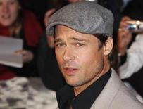 """<p>Actor Brad Pitt poses at the premiere of """"Beowulf"""" in London in this November 11, 2007 file photo. REUTERS/Anthony Harvey</p>"""