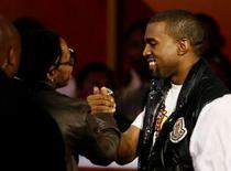 """<p>Kanye West (R) accepts the award for best collaboration for """"Good Life """" with T-Pain at the 2008 BET Awards in Los Angeles June 24, 2008. REUTERS/Mario Anzuoni</p>"""