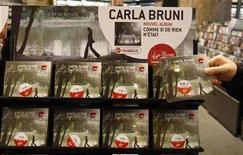 <p>New albums of France's first lady Carla Bruni-Sarkozy are displayed on its official launch in a store in Paris July 11, 2008. REUTERS/Eric Gaillard</p>