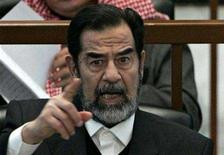 <p>Ousted Iraqi President Saddam Hussein reacts in court during the Anfal genocide trial in Baghdad December 21, 2006. REUTERS/Nikola Solic</p>