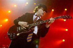 <p>Angus Young, lead guitarist with Australian rock band AC/DC plays during the band's concert at the Hammersmith Apollo, London, October 21, 2003. REUTERS/Toby Melville</p>