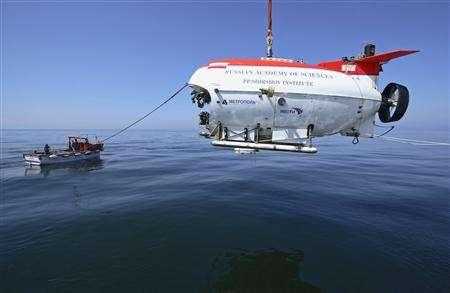 The MIR-2 submarine is lowered into the waters of Siberia's Lake Baikal during a test-run of a diving expedition July 24, 2008. REUTERS/Zorikto Dagbaev