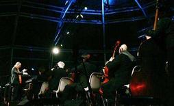 <p>Italian movie composer Ennio Morricone (L) conducts the Sinfonietta orchestra during a Christmas concert in Milan December 16, 2006. REUTERS/Alessandro Garofalo</p>