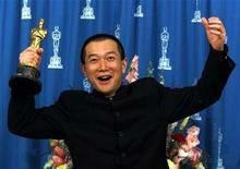 """<p>Tan Dun celebrates with the Oscar he won for Best Original Score for the movie """"Crouching Tiger, Hidden Dragon"""" at the 73rd annual Academy Awards at the Shrine Auditorium, March 25, 2001 in Los Angeles, California. REUTERS/Sam Mircovich</p>"""