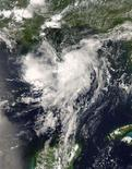 <p>National Aeronautics and Space Administration (NASA) satellite image shows Tropical Storm Edouard in the Gulf of Mexico photographed at 19:30 GMT, August 3, 2008. T REUTERS/NASA/Handout</p>