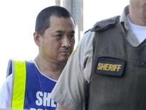 <p>Vince Weiguang Li (L), suspect in the murder of Tim McLean aboard a Greyhound bus in Manitoba, is escorted by sheriff officers on his way to a court appearance in Portage la Prairie August 5, 2008. REUTERS/Fred Greenslade</p>