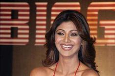 "<p>Bollywood actress Shilpa Shetty smiles during a news conference to announce the launch of ""Bigg Boss"" season 2 show on Colors television channel in Mumbai August 6, 2008. Shetty will host the show which will have 14 contestants and premiers on August 17. REUTERS/Manav Manglani</p>"