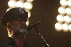 <p>Sting wears an NYPD hat on stage while performing with his band The Police during their farewell concert at Madison Square Garden in New York August 7, 2008. REUTERS/Brendan McDermid</p>