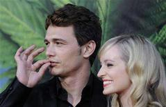 """<p>Cast member James Franco (L) and actress Ahna O'Reilly attend the premiere of the film """"Pineapple Express"""" in Los Angeles July 31, 2008. REUTERS/Phil McCarten</p>"""