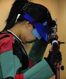 <p>Du Li da China chora depois da rodada final da prova de carabina de ar de 10m. Ela era a grande esperança da China conquisatar a primeira medalha de ouro dos Jogos, mas a atiradora terminou a competição na quinta posição. Photo by Desmond Boylan</p>