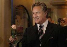 """<p>Don Johnson arrives with a rose for a musical premiere of """"Miami Nights"""" in Munich November 7, 2007. REUTERS/Michaela Rehle</p>"""