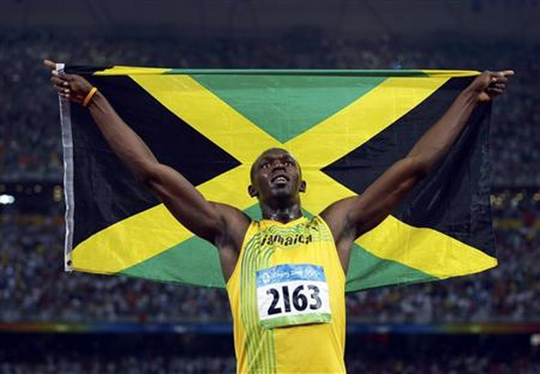 17dbab1a5f5 left. right. Usain Bolt of Jamaica waves his national flag after winning  the men s 100m final ...
