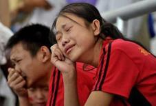 <p>Torcedores chineses choram após a desistência de Liu Xiang na prova dos 110m com barreira dos Jogos de Pequim. O campeão de Atenas-2004 está lesionado. Photo by China Daily</p>