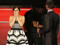 """<p>America Ferrera reacts as she is presented with the Chevy Entertainer of the Year award during the taping of the 2008 """"NCLR Alma"""" awards at the Civic Auditorium in Pasadena, California, August 17, 2008. REUTERS/Mario Anzuoni</p>"""