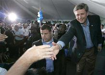 <p>Prime Minister of Canada Stephen Harper (R) shakes hands with Conservative Party supporters after his speech at the Croatian Parish Park in Mississauga August 18, 2008. REUTERS/Mike Cassese</p>