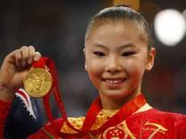 <p>Foto de arquivo da ginasta chinesa He Kexin, ganhadora de duas medalhas de ouro, que terá sua idade investigada pela Federação Internacional de Ginástica a pedido do COI. Photo by Hans Deryk</p>
