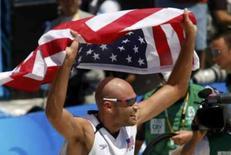 <p>O americano Philip Dalhausser comemora o ouro Olímpico, conquistado com a vitória sobre o Brasil. Photo by Gil Cohen Magen</p>