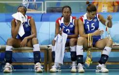 <p>Jogaram cubanas no banco de reservas após derrota para China na disputa da medalha de bronze dos Jogos de Pequim, neste sábado. Photo by Yves Herman</p>