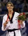 <p>Natália Falavigna posa com a medalha de bronze conquistada no taekwondo dos Jogos de Pequim, neste sábado, a 1a medalha do Brasil na modalidade. Photo by Alessandro Bianchi</p>