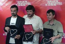 """<p>Actors Leon Lucev (L) and Slavko Stimac (R) and the director Goran Rusinovic pose with their awards """"Heart of Sarajevo"""" for the movie """"Buic Riviera"""" at the 14th Sarajevo film festival August 23, 2008. Lucev and Stimac were chosen as best actors for their role in the film. A Croatian film about two Bosnian immigrants who left the country during the 1992-95 war for a new life in the United States was chosen on Saturday as the best movie at the 14th Sarajevo film festival. REUTERS/Danilo Krstanovic</p>"""
