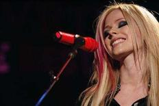 """<p>Canadian singer Avril Lavigne performs the song """"Girlfriend"""" after the announcement of her 2008 """"Best Damn Tour"""" in Los Angeles November 6, 2007. Malaysia has allowed Canadian pop star Avril Lavigne to hold a concert ahead of the country's independence day celebrations, reversing a decision to bar the performance following protests by an Islamist party. REUTERS/Mario Anzuoni</p>"""