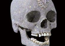 <p>A diamond-encrusted platinum skull by British artist Damien Hirst is seen in this undated handout file photograph released in London June 1, 2007. REUTERS/Prudence Cuming Associates/Handout/Files</p>