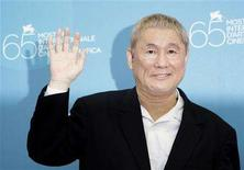 """<p>Japanese director Takeshi Kitano waves during a photocall at the Venice Film Festival August 28, 2008. """"Akires to kame"""" (Achilles and the Tortoise) movie by Japan director Kitano is shown in competition at the Venice Film Festival. REUTERS/Max Rossi</p>"""