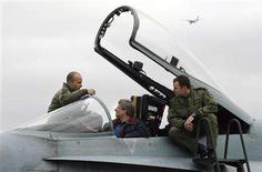 <p>Canadian Prime Minister Stephen Harper sits in the cockpit of a CF-18 Canadian Armed Forces fighter jet talking to Captains Mark Hickey (R) and Brent Handy (L) during his Canadian Western Arctic tour in Inuvik, Northwest Territories, August 28, 2008. REUTERS/Todd Korol</p>