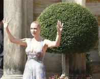 <p>Katharina Wagner waves as she arrives for the opening of this year's Bayreuth Wagner opera festival outside the so-called Gruener Huegel (Green Hill) opera house in Bayreuth July 25, 2007. REUTERS/Michael Dalder</p>