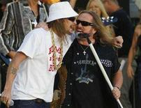 """<p>Singer Kid Rock (L) performs with Johnny Van Zant (R) and his band Lynyrd Skynyrd on ABC's """"Good Morning America"""" in New York August 22, 2008. REUTERS/Brendan McDermid</p>"""