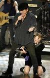 <p>Singer Brian Johnson (top) and guitarist Angus Young of ACDC perform at New York's Waldorf Astoria Hotel in this March 10, 2003 file photo. REUTERS/Mike Segar</p>