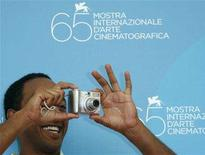 "<p>Actor Aaron Arefe takes a picture of photographers during a photocall at the Venice Film Festival September 2, 2008. Arefe stars in the movie ""Teza"" by Ethiopian director Haile Gerima which is presented in competition at the Venice Film Festival. REUTERS/Denis Balibouse</p>"